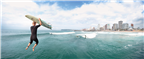 A surfer jumps off one of the piers in Durban int...