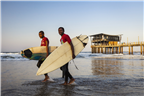 Two local surfers walking past Moyo on the Durban...