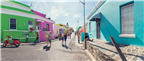 UK couples walking past the colourful Bo-Kaap hou...