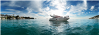 Panoramic view of people on a yacht anchored in C...