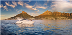 Panorama of a yacht in Camps Bay with the Twelve ...