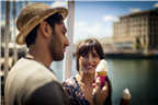 A young mixed race couple enjoying an ice-cream o...