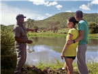 A game drive guide explaining and talking with a ...