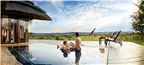 US couple relaxing in a pool at a lodge in the Ma...