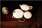 Top view of a teapot set and a kettle in a luxury...