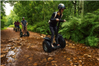 People riding through a stream on the segway tour...