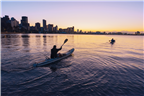 Kayakers kayaking near Wilson's Wharf with the Du...