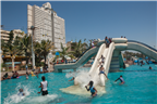 People enjoying the waterslides at the beachfront...