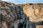 Man looking down over Bourke's Luck Potholes in M...