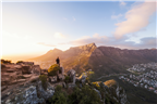 A man looking at the view from Lion's Head in Cap...