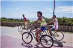 People riding bicycles along Durban Beachfront