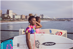 Two women holding surfboards at Durban beachfront