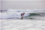 Woman surfing in Durban beach