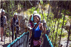 A smiling woman on a canopy tour