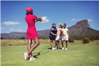People taking a photo on a golf course