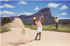 A woman playing golf in Limpopo