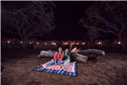 A mother and son star gazing in the Northern Cape