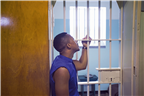 A man looking into a cell on Robben Island