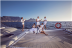 People dressed in white on a yacht