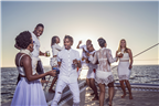 People dressed in white partying on a yacht
