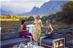 Three women wine tasting on a wine farm