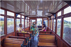 Women sitting inside the Franschhoek Wine Tram