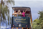 Women riding on the top deck of the Franschhoek W...